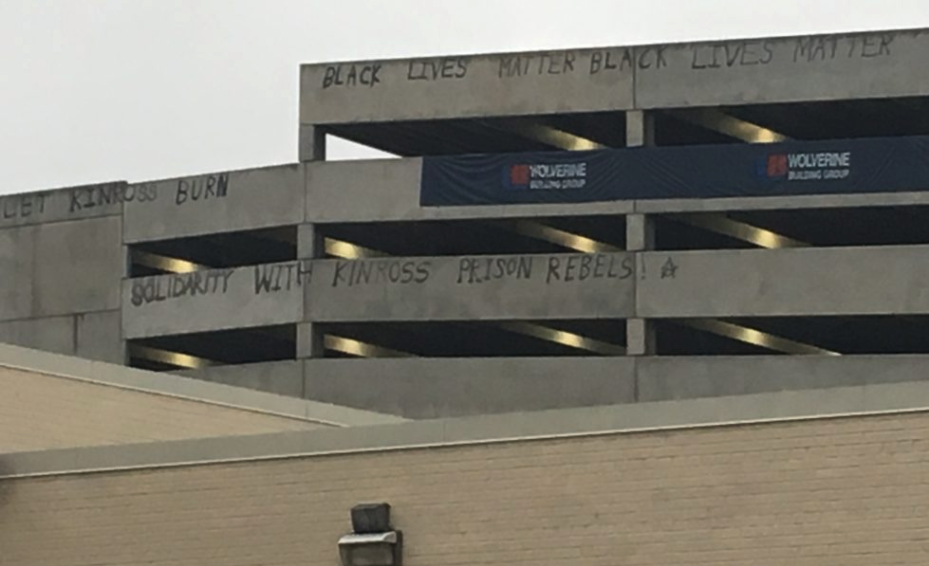 "Graffitti reading ""Black Lives Matter"". ""Let Kinross Burn"" and ""Solidarity with Kinross Rebels"""